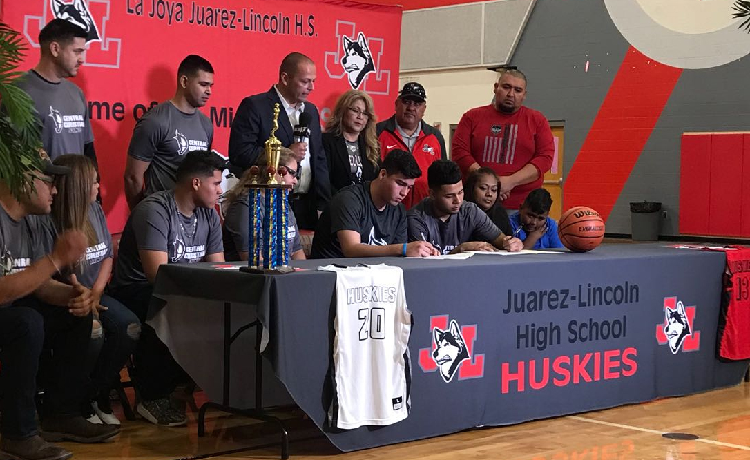 Luis Garza (seated left) and Cruz Mendoza (seated right) each signed a letter of intent to join the Central Christian College of the Bible Saints for the 2018-19 school year.