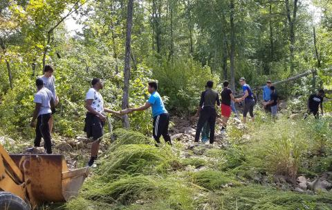 Members of the CCCB men's basketball team gathered stones from a stream bed in the Kiamichi Mountains last weekend as part of a mission trip.