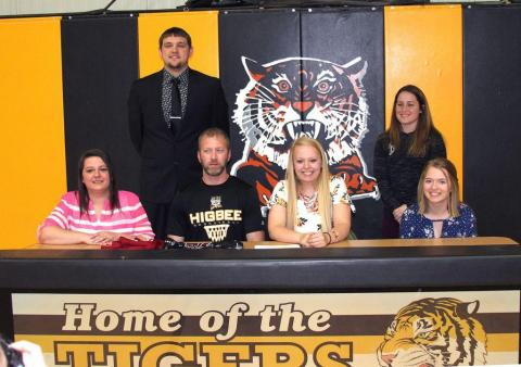 Alexis Whisenand signed her letter of intent on Friday morning at Higbee High School.